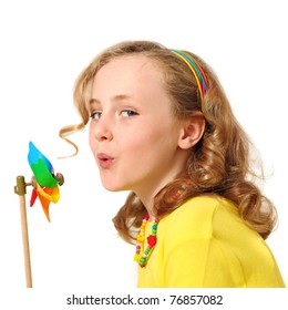 pretty child showing energy saving concept blowing windmill