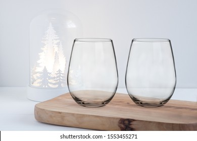 Pretty christmas styled stemless wine glass Mockup. Great for overlaying your custom quotes, decals and designs for selling custom glasses.