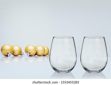 Pretty christmas styled stemless wine glass Mockup with 2 glasses. Great for overlaying your custom quotes, decals and designs for selling custom glasses.