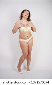 39e8201778 pretty chubby girl wearing fashionable yellow underwear and loves her body  and herself. plump woman