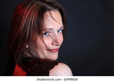 Pretty close up portrait of woman in her forties with great skin and creative lighting