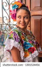 Pretty and colorful Mayan girl in Yucatan Young smiling girl inviting tourism to visit Merida in the Yucatan peninsula