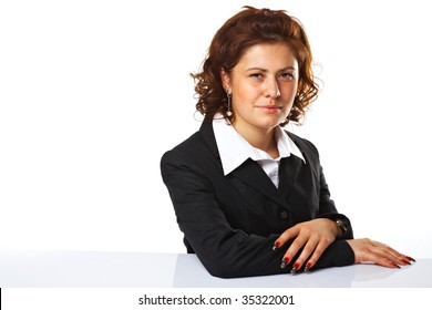 Pretty confident business woman with hands folded, against white background