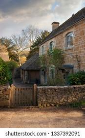 Pretty Cotswold cottage at Naunton, Gloucestershire, England