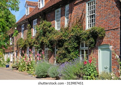 Pretty cottages along a village street during the Summertime, Hambledon, Oxfordshire, England, UK, Western Europe.