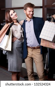 Pretty couple is glad to go shopping