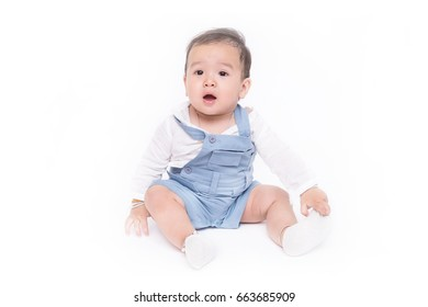 Pretty cute surprising baby wearing Mechanic Jumpsuit in studio isolated on white background