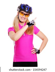 pretty cyclist girl on white background pointing to the copy space area