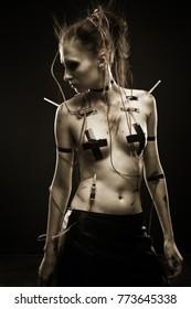Pretty dirty cyberpunk girl posing over dark background