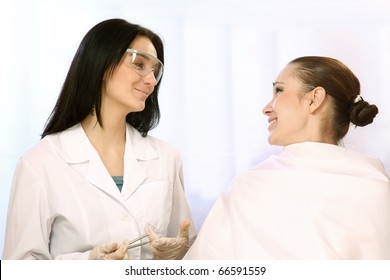 Pretty doctor and young woman