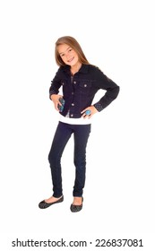 A pretty eight year old girl standing isolated for white background in jeans and a jean jacket