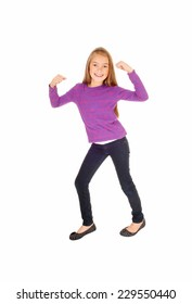 A pretty eight year old girl in jeans and a sweater dancing, isolated on white background.