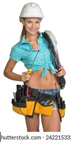 Pretty electrician in helmet, shorts, shirt, tool belt with tools holding screwdriver and an electric cable. Isolated over white background