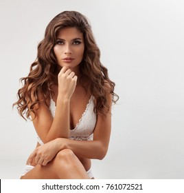 Pretty elegant lady in beautiful lingerie against white background