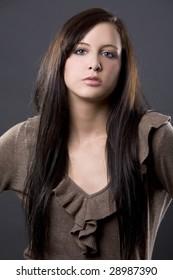 pretty European model with long brown healthy hair