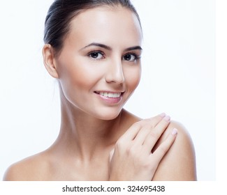 Pretty face of beautiful smiling woman - posing at studio isolated on white.