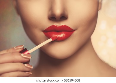 Pretty face beauty lady Red woman lips close up. Beautiful model girl with lipstick. Products Treatment. She gets gloss