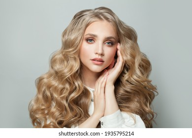 Pretty face. Cute blonde woman with long healthy hair on white background