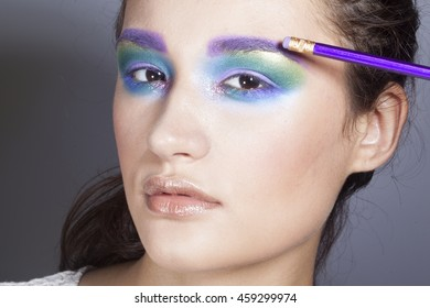 pretty fashion model girl with colorful make up