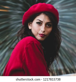Pretty and fashionable French woman wearing red beret
