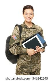 Pretty female cadet of military school on white background