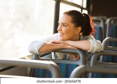 pretty female commuter daydreaming on bus