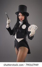 Pretty female magician dressed in performer costume suit with magic wand and playing cards. Studio  sc 1 st  Shutterstock & Female Magician Images Stock Photos u0026 Vectors | Shutterstock
