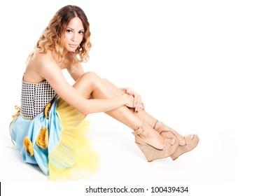 pretty female model in summer dress full body shot sit studio shot white