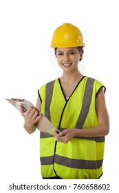 Pretty female worker with clipboard and hard hat