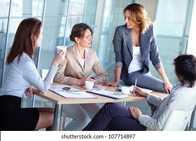 Pretty females discussing business matters in the boardroom