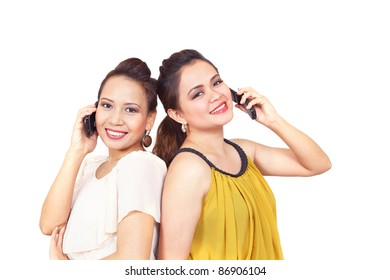Pretty filipino girls on mobile phones smiling and chatting