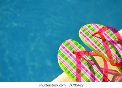 Pretty flip flops by the swimming pool. Room for your text.