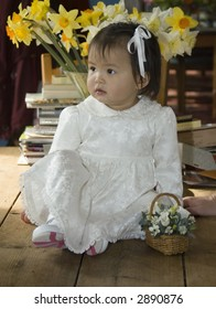 pretty flower girl in white silk dress