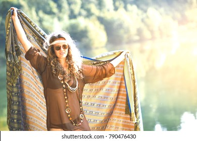 Pretty free hippie girl with a cloth. Outdoor in peace and free love. Top view - Vintage effect photo