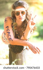 Pretty free hippie girl. Peace. Body painting. Outdoor in peace and free love. Top view  - Vintage effect photo