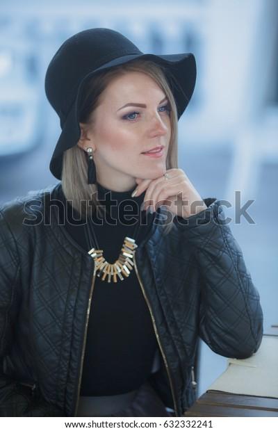 Pretty girl in black hat