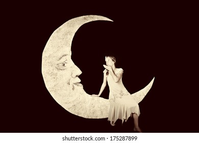 Pretty girl blowing kiss to vintage paper moon