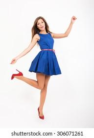 Pretty girl in blue dress, studio full length portrait