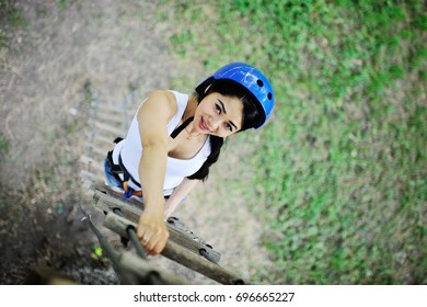 pretty girl in blue helmet and protective equipment is involved in extreme sports competitions