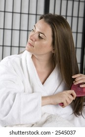 Pretty girl brushing her hair