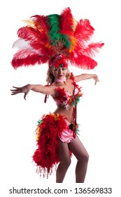 Pretty girl in carnival costume dancing isolated