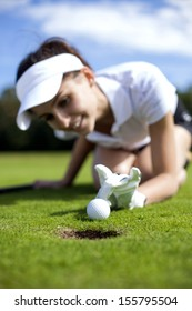 Pretty girl cheating on golf field, tried to push the ball with her finger