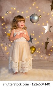 pretty girl with christmas decoration lights and stars smiling background