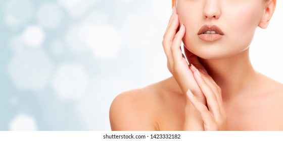 Pretty girl with clean and fresh skin. Skin care concept, abstract blurred background