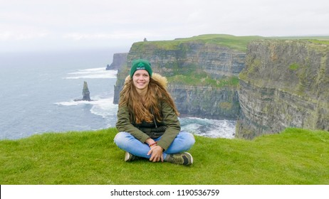 Pretty girl at the Cliffs of Moher - wonderful scenery