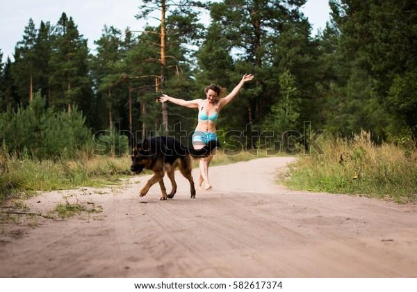 Pretty girl and dog German shepherd outdoor