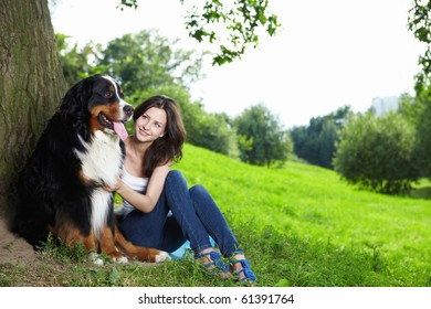 A pretty girl with a dog in the park