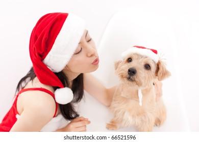 pretty girl and dog in santa hat at Christmas