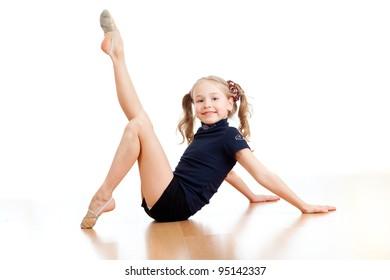pretty girl doing gymnastics over white background