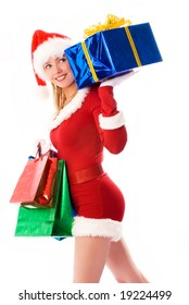 pretty girl dressed as Santa with Christmas presents